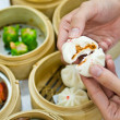 Stock Photo: Steamed dumpling with hand