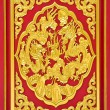 Stock Photo: Dragon carve gold paint on temple door
