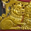 Stock Photo: Lion wood carve gold paint