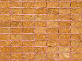 Pattern of laterite stone wall surface — Stock Photo