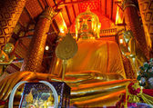 Golden Buddha statue in temple — Stok fotoğraf