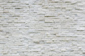 Modern pattern of real stone wall — Stock Photo