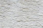 Modern pattern of real stone wall — Stock Photo