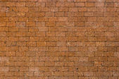 Red color of decorative laterite stone wall surface — Stock Photo