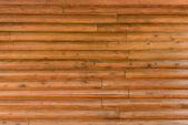 Schild met een groot aantal parallelle houten logboeken — Stockfoto