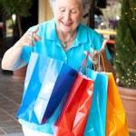 Senior Shopper Inspects Bags — Stock Photo #11417884