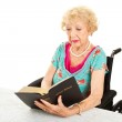 Disabled Senior Woman Reads Bible — Stock Photo #11869971