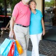 Happy Senior Couple Goes Shopping — Stock Photo