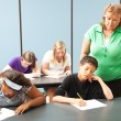 Teacher Monitors Standardized Test — Stock Photo #13436093