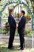 Gay Marriage - Under the Floral Arch — Stock Photo