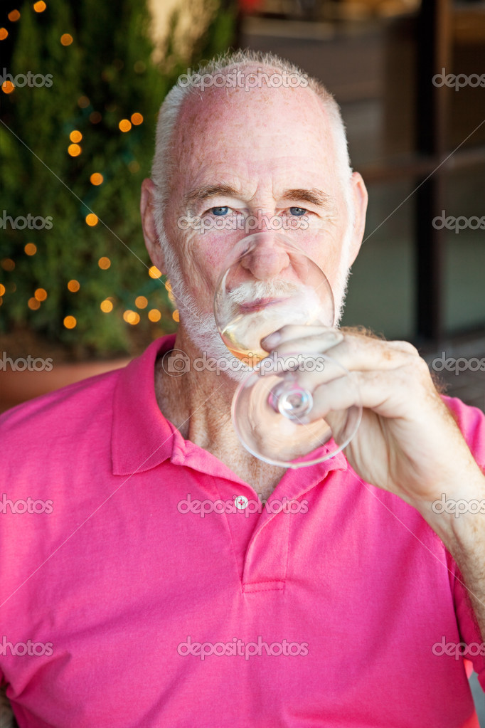 Senior man enjoying a glass of white wine.   — Stock Photo #13436018