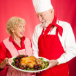 Chef and Homemaker with Holiday Dinner - Stock Photo