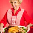 Grandma Serves Holiday Dinner — Stock Photo