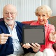 Stock Photo: Seniors Point to Tablet PC