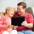 Teaching Mom the Tablet PC — Stock Photo #13817603