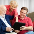 Family Using Tablet PC - Stock Photo