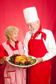 Chef and Homemaker with Holiday Dinner — Stock Photo