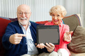 Seniors Point to Tablet PC — Stock Photo