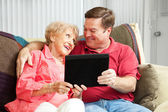 Teaching Mom the Tablet PC — Stock Photo