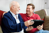 Father and Son Enjoying Tablet PC — Stock Photo