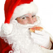 Santa Claus Eating Christmas Cookie — Stock Photo #14473621