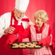 Chef and Housewife Baking Cookies - Stock Photo
