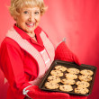 Retro Housewife Bakes Chocolate Chip Cookies — Stock Photo #14473671