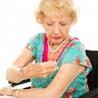 Senior Woman Gives Self Injection - Stockfoto