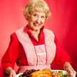 Stock Photo: Retro Housewife Cooks Holiday Meal
