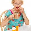Healthy Senior Woman Takes Medication — Stock Photo #14473769