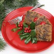 Christmas Fruitcake on Red Plate — Stock Photo