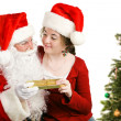 Child Gets Christmas Present From Santa - Stock Photo