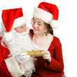 Girl Gets Christmas Present From Santa - Stock Photo