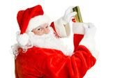 Santa Claus Stuffs a Christmas Stocking — Stock Photo