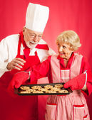 Chef and Housewife Baking Cookies — Stock Photo