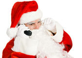 Santa Claus Takes Phone Call — Stock Photo