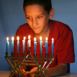 Stock Photo: Young Boy With Hanukkah Menorah