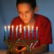 Young Boy With Hanukkah Menorah - Stock Photo