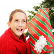 Little Boy Shaking Christmas Gift — Stock fotografie