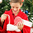 Little Boy Opening Christmas Stocking - Foto Stock