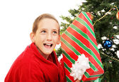Little Boy Shaking Christmas Gift — Stock Photo