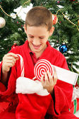 Little Boy Opening Christmas Stocking — Stock Photo