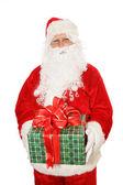 Isolierte santa holding weihnachtsgeschenk — Stockfoto