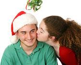 Christmas Kiss Under Mistletoe — Stock Photo