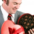 Man Gets Chocolate for Valentines Day - 图库照片