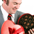 Man Gets Chocolate for Valentines Day - Stock Photo