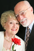 Elegant Senior Couple with Rose — Stock Photo