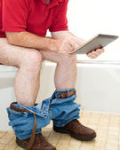 Man On Toilet with Tablet PC — Stock Photo