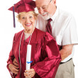 Husband Congratulates College Graduate Wife - Stock Photo