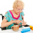 Disabled Senior Examining Her Medication — ストック写真